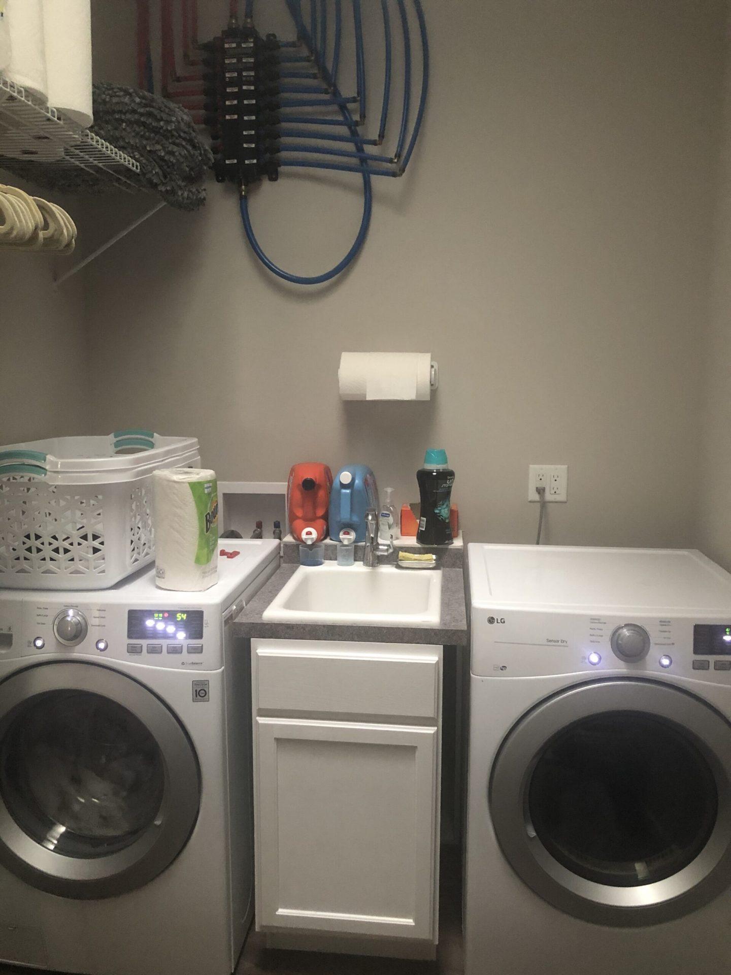 Modern Coastal Sanctuary | Laundry Room | Before